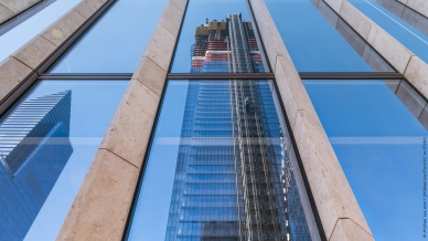 10 Hudson Yards and 30 Hudson Yards reflected on the east facade of 35 Hudson Yards