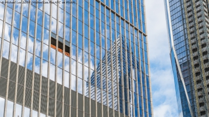 Reflection of 10 Hudson Yards on the south facade of 35 Hudson Yards