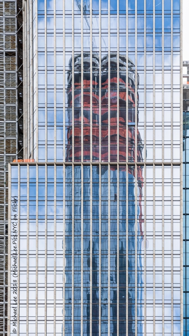 Reflection of 15 Hudson Yards on the south facade of 35 Hudson Yards as viewed from the roof of The Shed