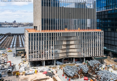 Podium level of 35 Hudson Yards with rail yard and Hudson River in the background. Also seen here are sections of the observatory level for 30 Hudson Yards.