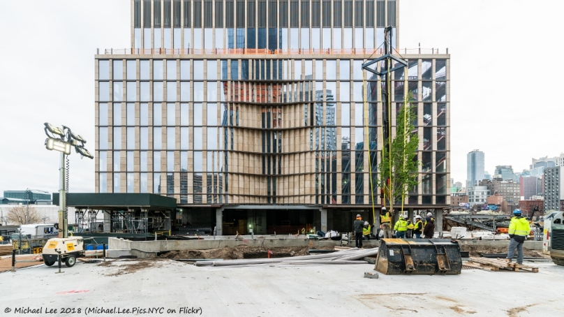 South facade podium level of 35 Hudson Yards with trees getting planted in the future Public Square and Gardens