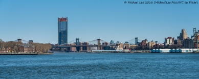 Governors Island and Two Bridges viewed from Water Taxi to Wall Street